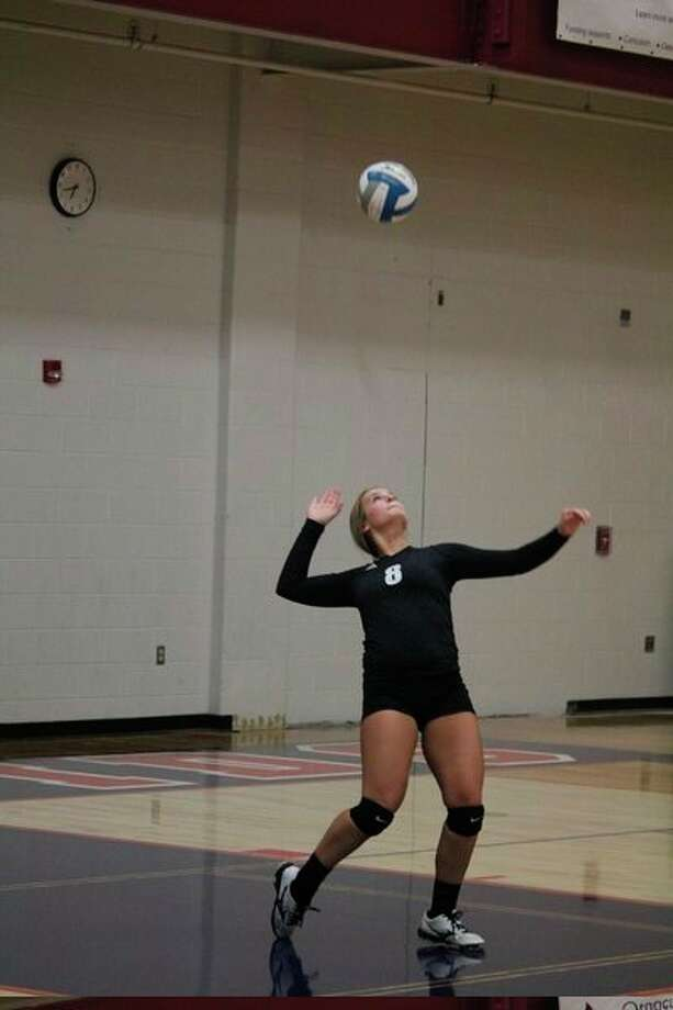 Mackenzie Wein gets set to serve the ball for Reed City against Manistee. (Pioneer photo/John Raffel)