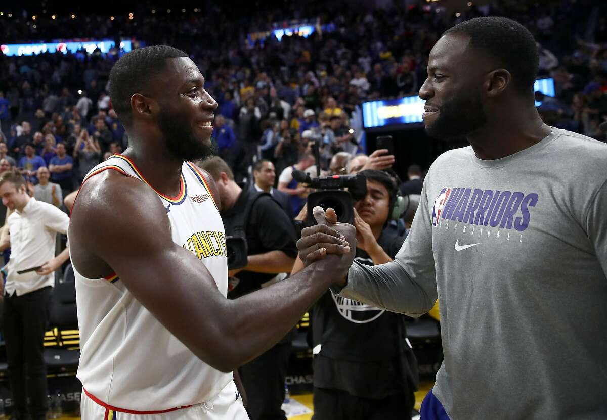 SAN FRANCISCO, CALIFORNIA - NOVEMBER 04: Eric Paschall #7 of the Golden State Warriors is congratulated by Draymond Green #23 after their win over the Portland Trail Blazers at Chase Center on November 04, 2019 in San Francisco, California. NOTE TO USER: User expressly acknowledges and agrees that, by downloading and or using this photograph, User is consenting to the terms and conditions of the Getty Images License Agreement. (Photo by Ezra Shaw/Getty Images)