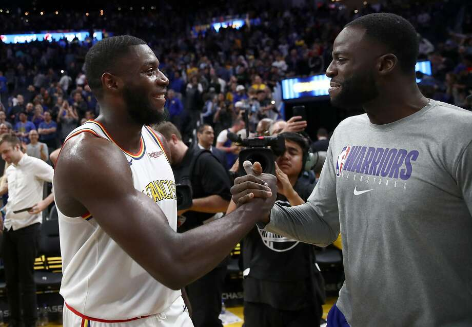 SAN FRANCISCO, CALIFORNIA - NOVEMBER 04:  Eric Paschall #7 of the Golden State Warriors is congratulated by Draymond Green #23 after their win over the Portland Trail Blazers at Chase Center on November 04, 2019 in San Francisco, California. NOTE TO USER: User expressly acknowledges and agrees that, by downloading and or using this photograph, User is consenting to the terms and conditions of the Getty Images License Agreement. (Photo by Ezra Shaw/Getty Images) Photo: Ezra Shaw, Getty Images