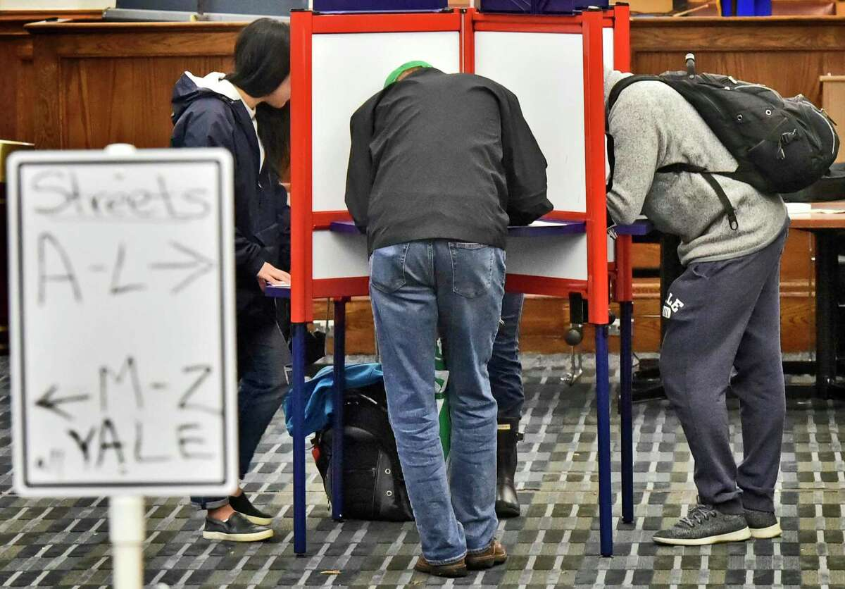 New Haven, Connecticut-, November 6, 2018: The New Haven Hall of Records polling station is the place where town and gown voters, Yalies who are registered New Haven residents and New Haven Ward-17 voters, meet Thursday to cast their ballot.