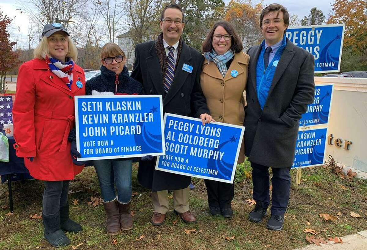 Second from right, Democrat candidate for Madison first selectman Peggy Lyons outside voting District 1 on Tuesday, Nov. 5, 2019.