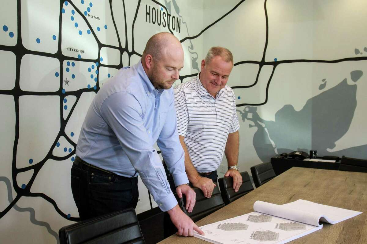 President Cullen Burton, left, and CEO Shawn McAlpin, of Burton Construction in a conference room with a map in the background showing the location of some of their projects in Houston. September 30, 2019.