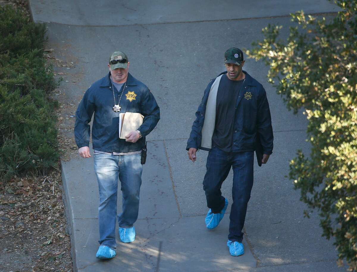 Officers from the San Francisco Police Department walk down Lucille Way in Orinda, Calif. on Friday, Nov. 1, 2019 after four people were killed and several left injured in a shooting during a Halloween party Thursday night.