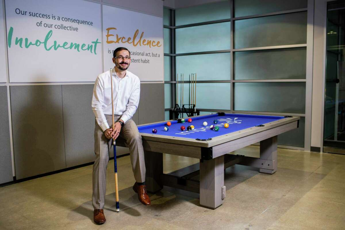 Improving - Houston president Devlin Liles inside the firm's office, Tuesday, Sept. 10, 2019, in Houston. After reaching their yearly goals, the company acquired a pool table.