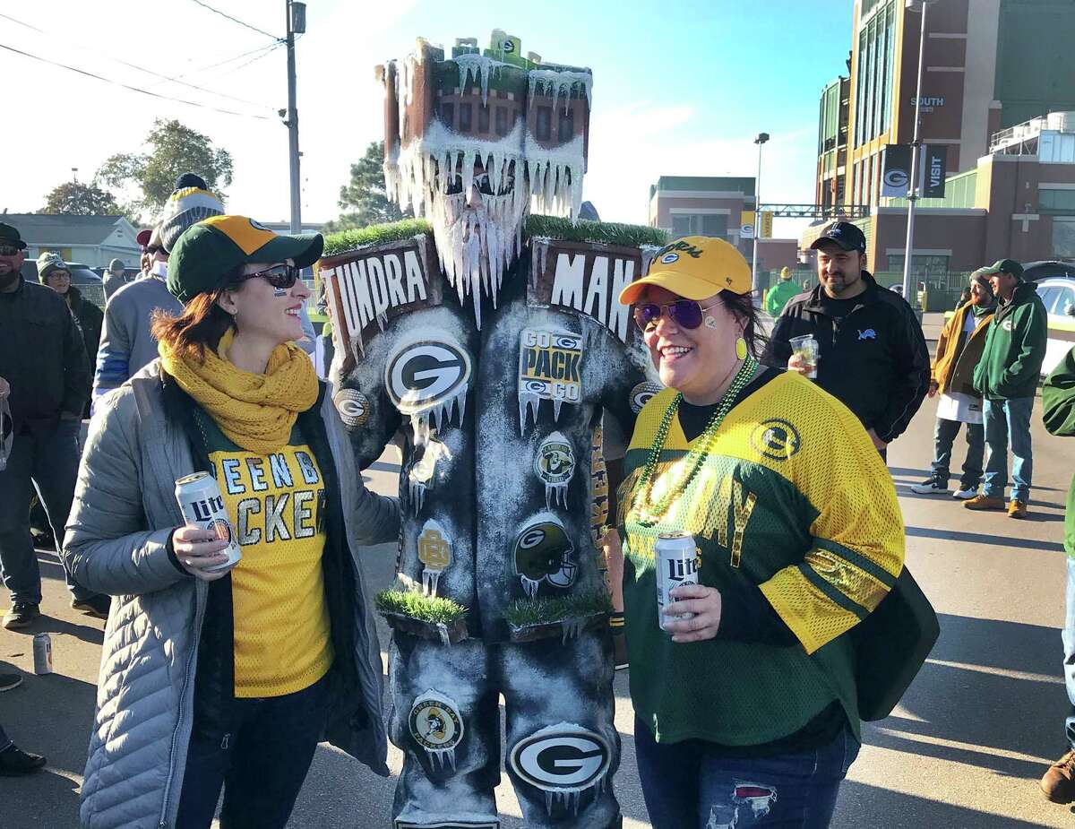 Jeff Kahlow of Fond du Lac, Wis., aka Frozen Tundra Man, celebrates with fans near Lambeau Field before a Green Bay Packers game.