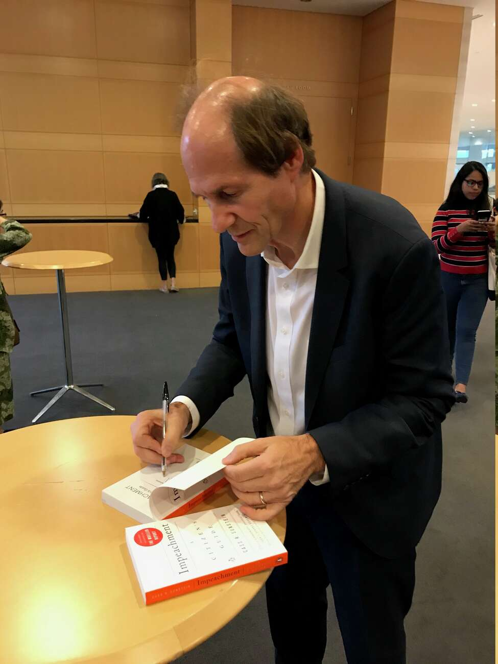 Harvard Law professor and Constitutional scholar Cass Sunstein signs copies of his book,