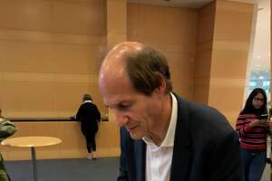 """Harvard Law professor and Constitutional scholar Cass Sunstein signs copies of his book, """"Impeachment: A Citizen's Guide"""" after his talk on Oct. 15 at Fordham Law School in New York City."""