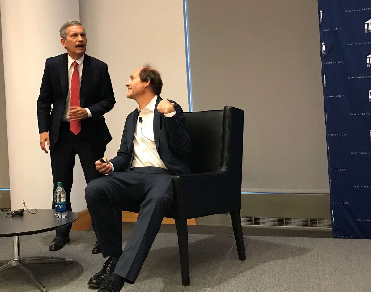 New York State Bar Association President Hank Greenberg, who moderated the discussion, talks with author and Constitutional scholar Cass Sunstein before his talk on the impeachment mechanism