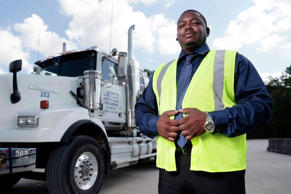 Chaun Bush, an executive of Jetco Delivery, with some of the delivery semi-tractors at the company headquarters Thursday, Sep. 26, 2019 in Houston, TX.