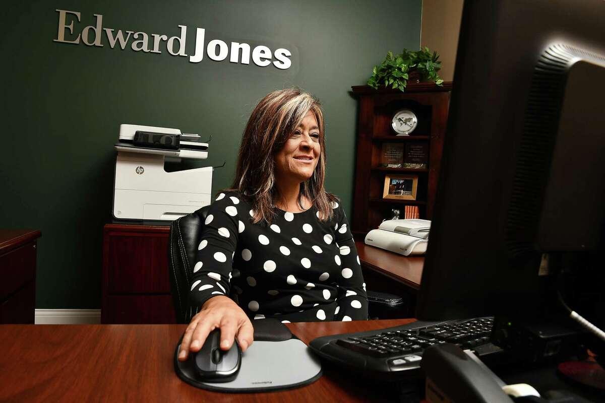 Senior branch administrator Kerrie Bass works at Edward Jones on Springbrook Plaza Dr. Wednesday Oct. 02,,2019.(Dave Rossman Photo)