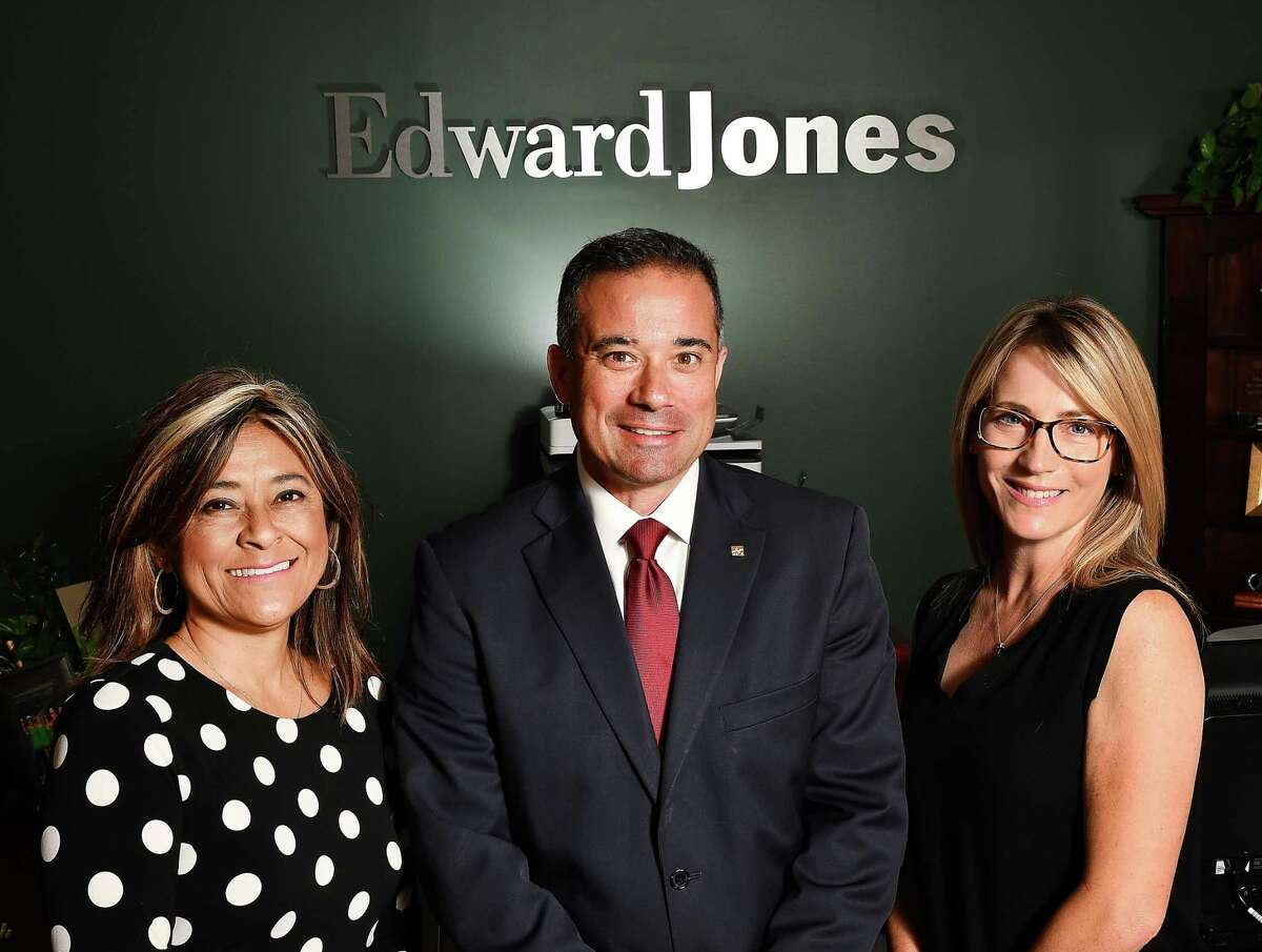Financial adviser Paul Dimiceli II with Kerrie Bass, left, and Melanie Dimiceli at one of Edward Jones' many area offices.