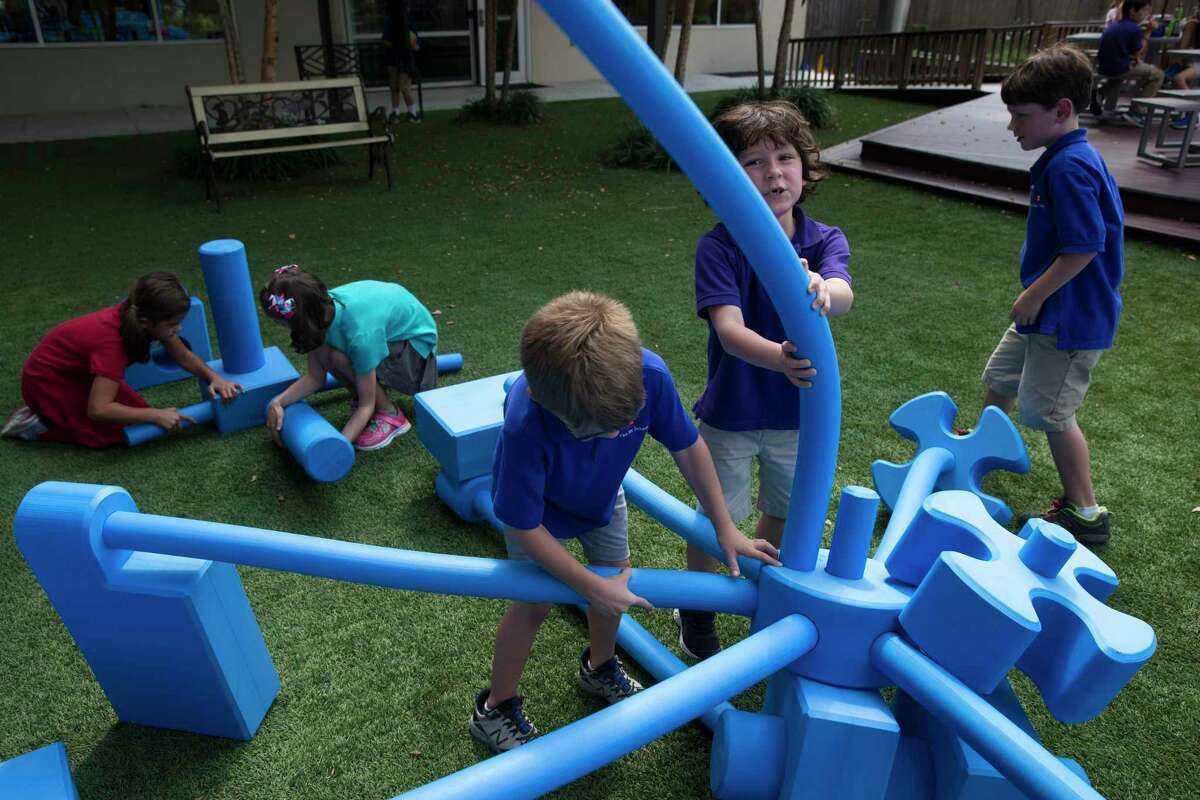 The Joy School kindergarteners Gray Farina, second right, and Harrison McNab, third right, buildling a block set on Thursday, Oct. 3, 2019, in Houston. It is an alternative school for students with learning disabilities and its mission is to get kids to leave and go back to traditional schools.