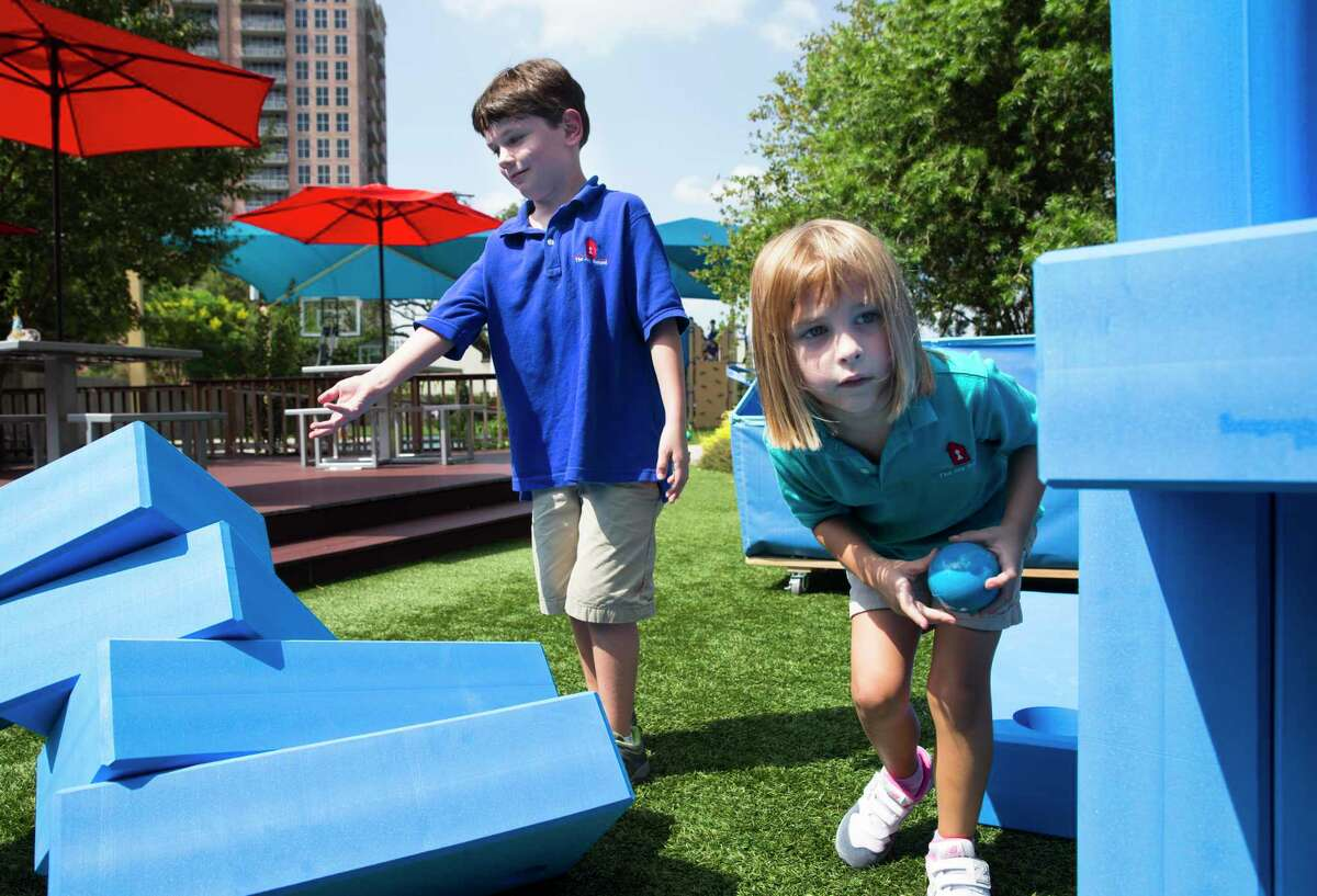 The Joy School kindergarteners Gray Nichols and Lily Breikjern (CQ) play the block set on Thursday, Oct. 3, 2019, in Houston. It is an alternative school for students with learning disabilities and its mission is to get kids to leave and go back to traditional schools.