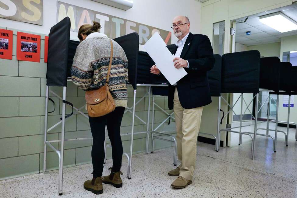 Troy Mayor Patrick Madden walks over to feed his ballot into the voting machine on Tuesday, Nov. 5, 2019, in Troy, N.Y. (Paul Buckowski/Times Union)