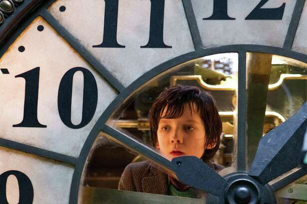 "In this image released by Paramount Pictures, Asa Butterfield portrays Hugo Cabret in a scene from ""Hugo."""