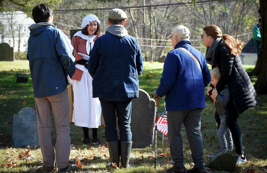 A group of participants gather to listen to Larkin Brown, a Wilton resident, portray Mable (Mehitabel) Elmer (1722-1744) during the Spirits of the Past cemetery walk and reenactment at Sharp Hill Cemetery in Wilton on Nov. 2. Photo: Matthew Brown / Hearst Connecticut Media / Stamford Advocate
