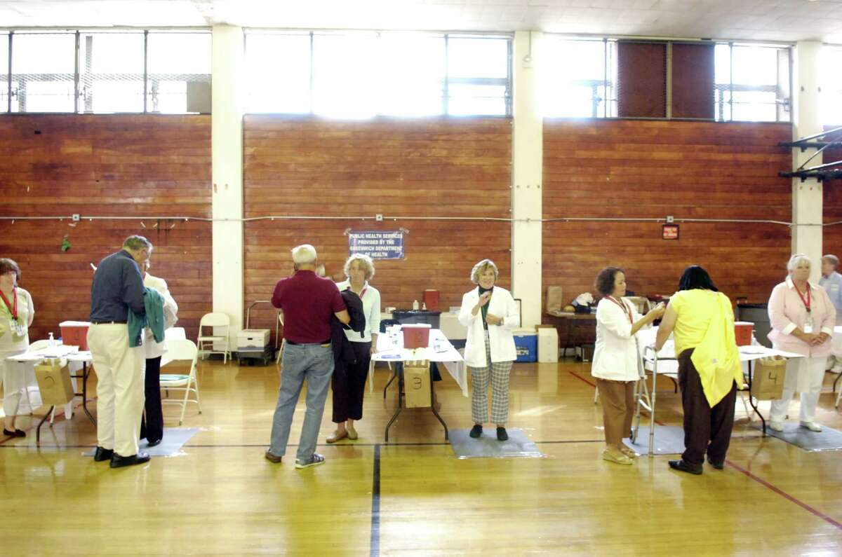 Greenwich Department of Health volunteers administer vaccines in 2009.
