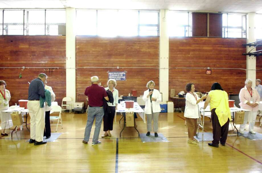 Greenwich Department of Health volunteers administer vaccines in 2009. Photo: File Photo