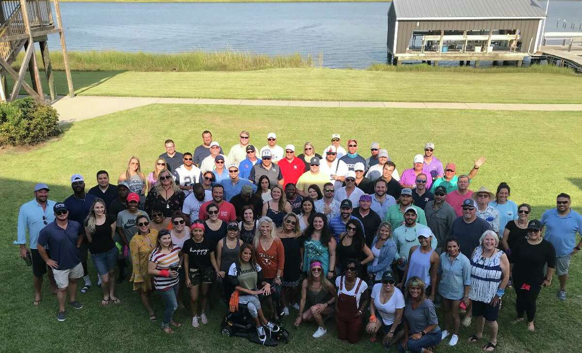 """The Signorelli Co. at its """"Hooked on Culture"""" company fishing retreat in Louisiana."""