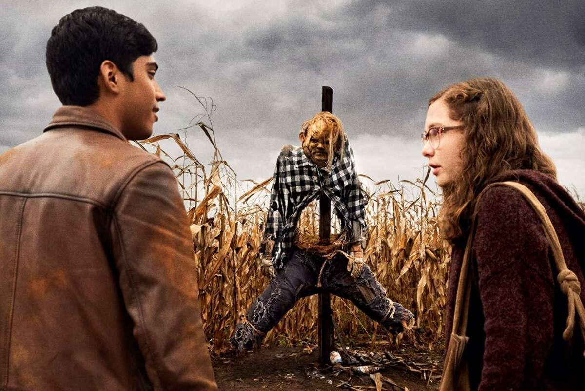 Michael Garza and Zoe Margaret Colletti encounter the scarecrow in