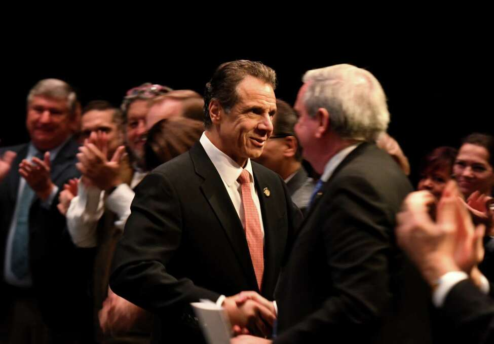 Gov. Andrew Cuomo, left, shakes hands with Schenectady Mayor Gary McCarthy during an announcement that the city will receive $10 million for the revitalization of Downtown Schenectady on Tuesday, Nov. 5, 2019, at Proctors Theatre in Schenectady, N.Y. The money was awarded to the city through the fourth round of the state's Downtown Revitalization Initiative, which invests annually in 10 plans across the state that are intended to turn around local communities. (Will Waldron/Times Union)