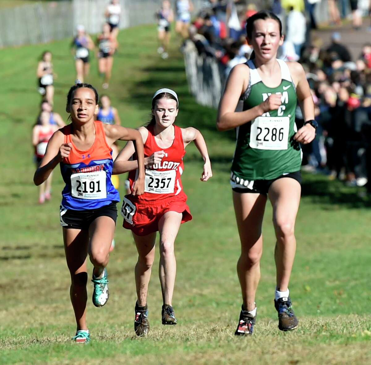 Manchester, Connecticut -Wednesday, November 1, 2019: The CIAC Girls Cross Country Open Championship Friday at Wickham Park in Manchester: 5th place finisher Daniella Grullon Pena of Danbury, left, Kathryn Rodrigues of Wolcot H.S., center, and Claire Daniels of New Milford H.S., right,