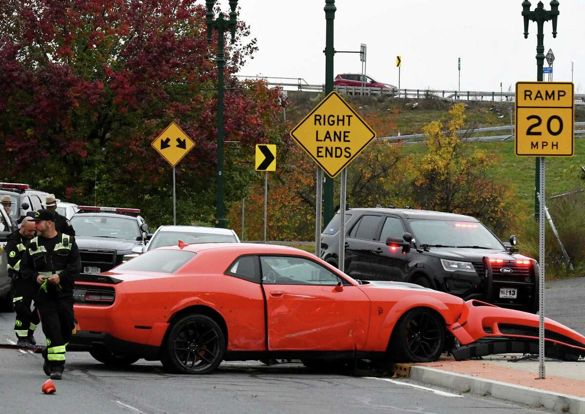 A Dodge Challenger, believed to be stolen from a car dealership Albany, crashed on Erie Boulevard following a police chase on Tuesday, Nov. 5, 2019, in Schenectady, N.Y. (Will Waldron/Times Union)