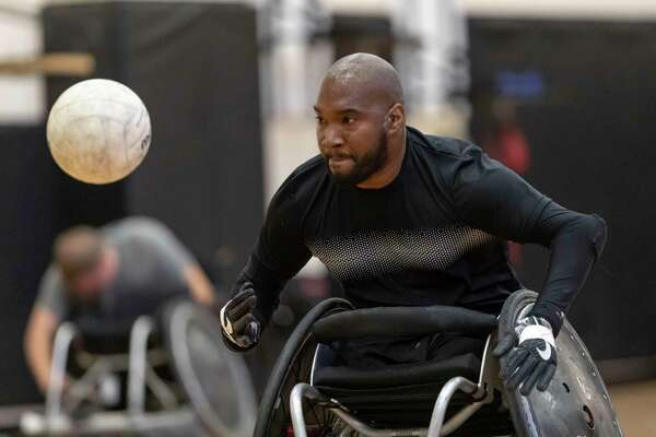 Carl Williams of Houston, chases down a lose ball during a wheelchair rugby practice Thursday, Sep 26, 2019, in Houston.
