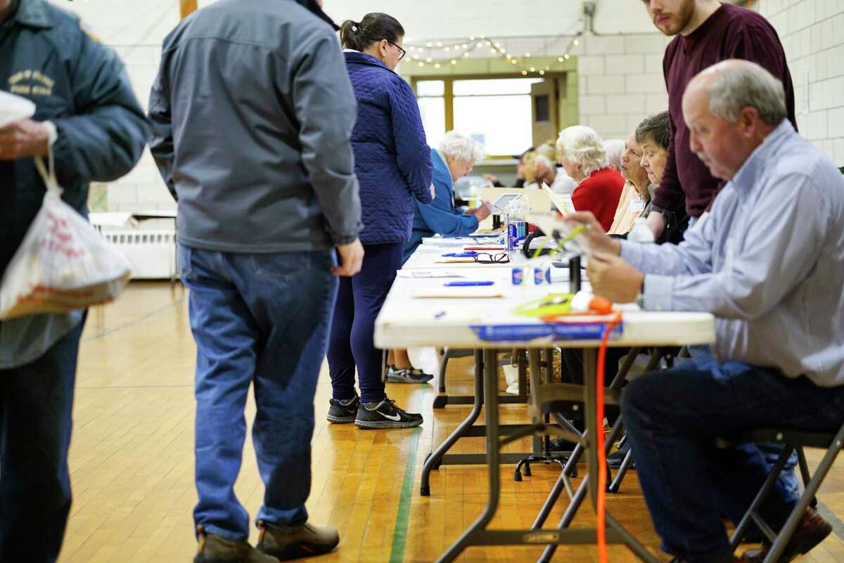 Election inspectors check in voters during voting at Holy Trinity Parish Center on Tuesday, Nov. 5, 2019, in Cohoes, N.Y. (Paul Buckowski/Times Union)