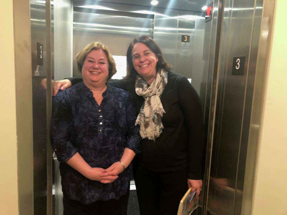 Shelton Library Director Joan Stokes, left, and library Children's Programmer Maura Gualtiere show off the new elevator at Plumb Memorial Library.