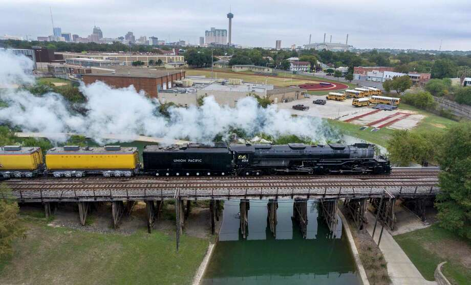 Union Pacific steam train No. 4014 crosses the San Antonio River on its way to Sunset Station east of downtown Tuesday, Nov. 5. It is one of 25 locomotives known as Bog Boys that were built for Union Pacific. Photo: William Luther /Staff Photographer / ©2019 San Antonio Express-News