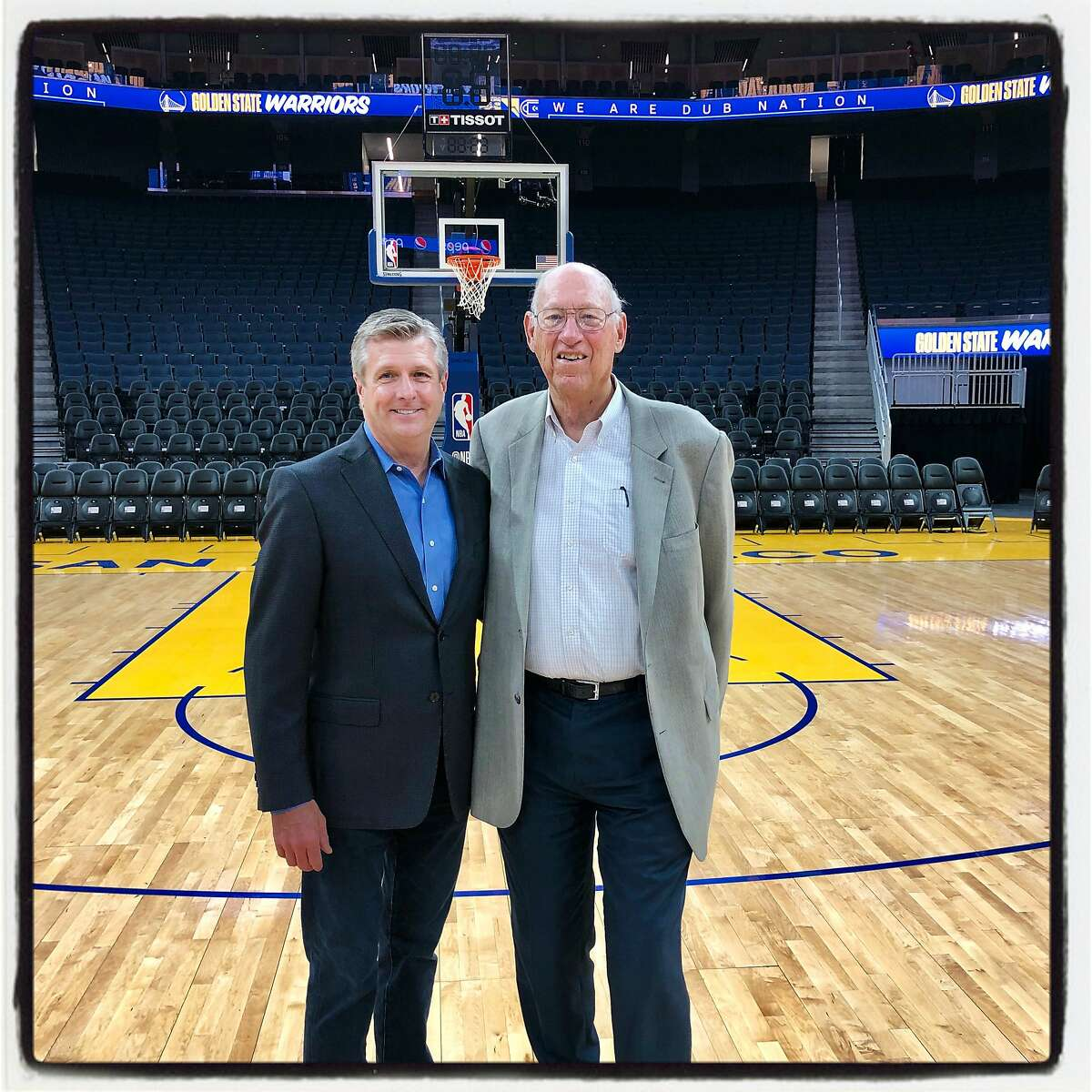Golden State Warriors President Rick Welts (left) with architect Art Gensler at Chase Center. Oct. 23, 2019.