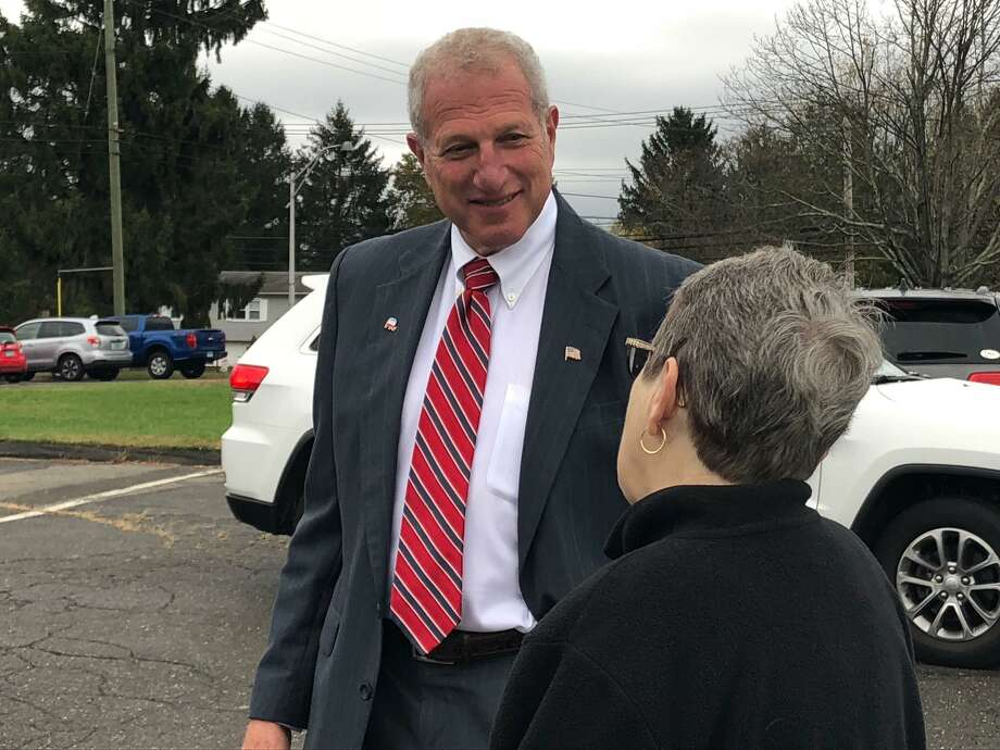 Mayor Mark Lauretti greets voters outside Long Hill School Tuesday, Nov. 5. Photo: Brian Gioiele / Hearst Connecticut Media / Connecticut Post