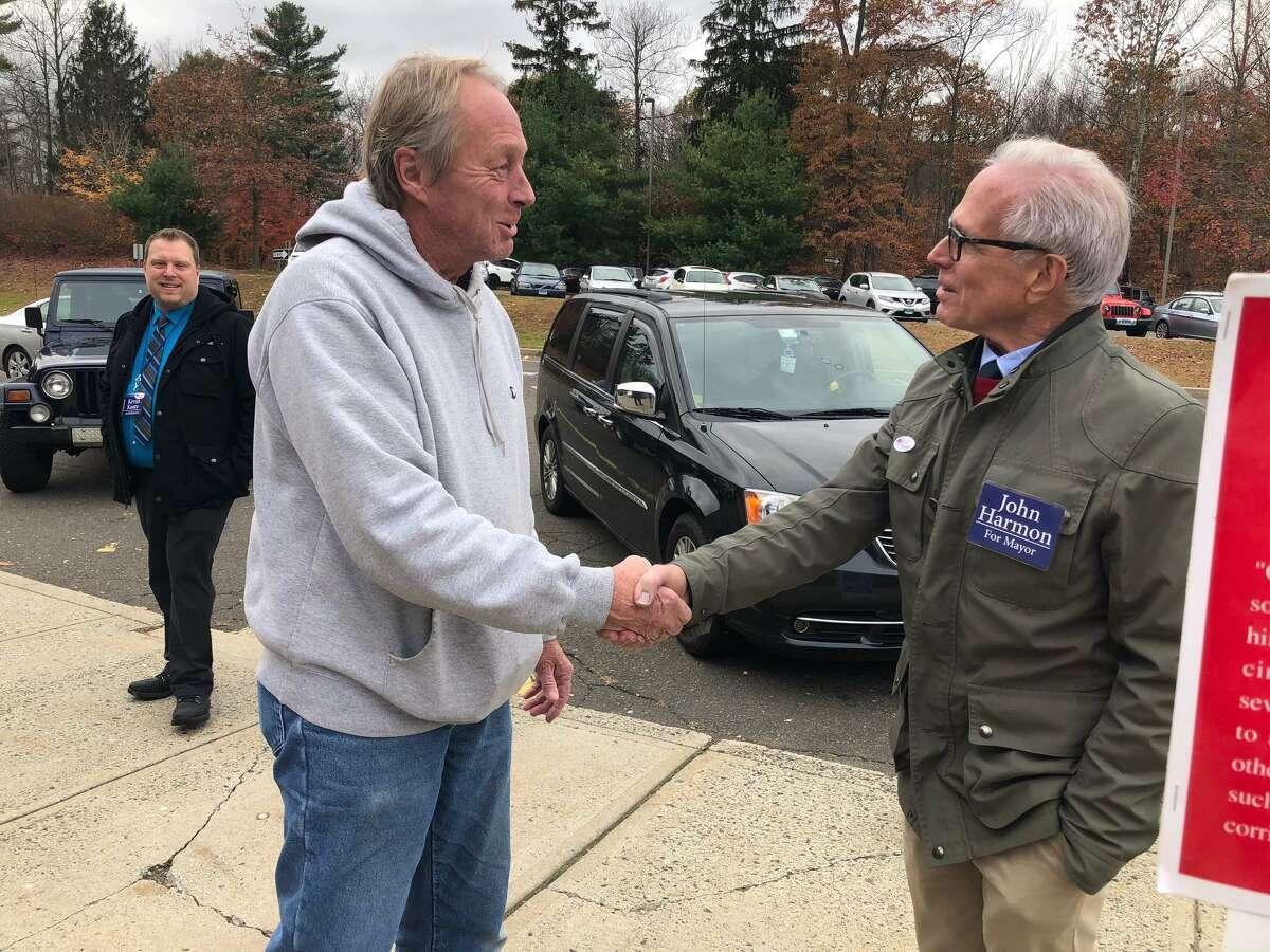Democrat mayoral candidate John Harmon talks to voters outside Shelton Intermediate School Tuesday, Nov. 5.