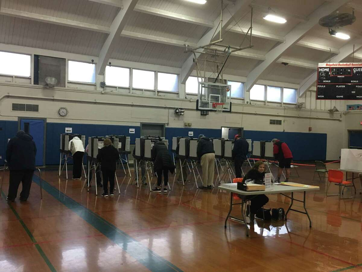 Ridgefield voters cast their ballots early Tuesday morning at Yanity gym.