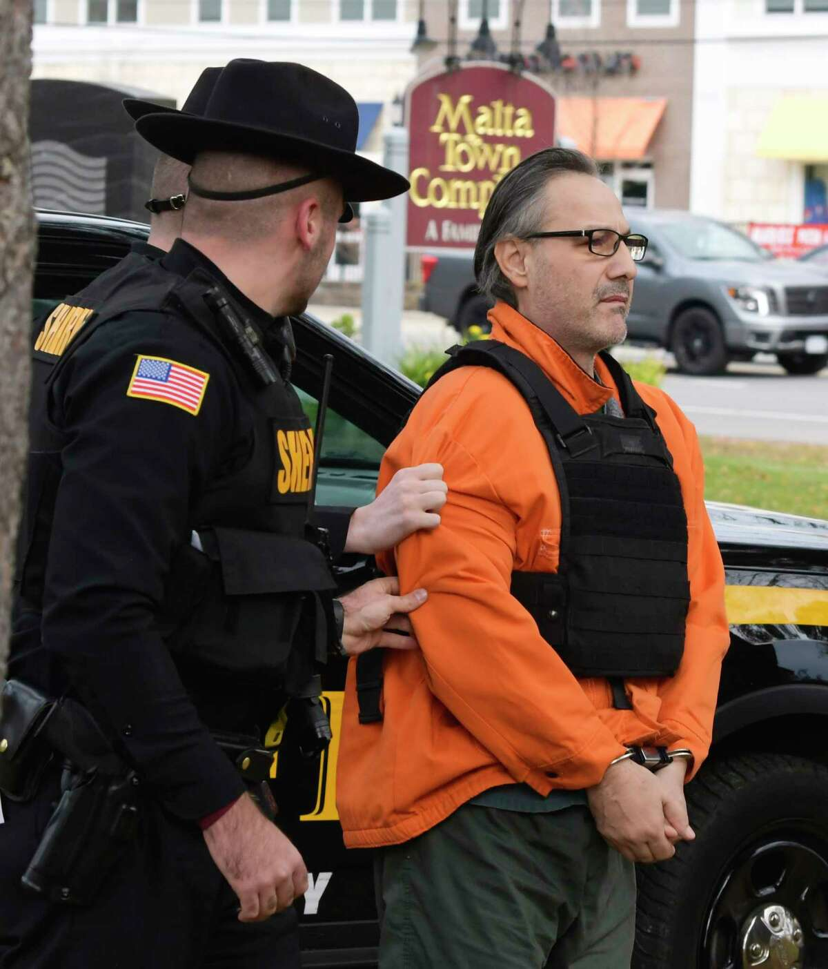 Georgios Kakavelos is brought into Malta Town Court for a court appearance on Tuesday, Nov. 5, 2019, in Malta, N.Y. Kakavelos and a co-defendant have been charged with murder and concealment of a corpse. (Paul Buckowski/Times Union)