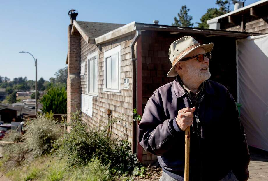 Mischa Seligman, 98, stands alongside his childhood home in Diamond Heights prior to the start of long-awaited affordable housing construction on the site. Photo: Jessica Christian / The Chronicle