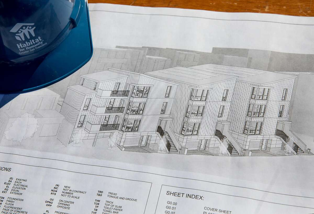 Plans for the future of Mische Seligman's childhood home and inherited property on Amber Drive in Diamond Heights are displayed on a table before the start of a groundbreaking held by Habitat for Humanity in San Francisco, Calif. Friday, Nov. 1, 2019.