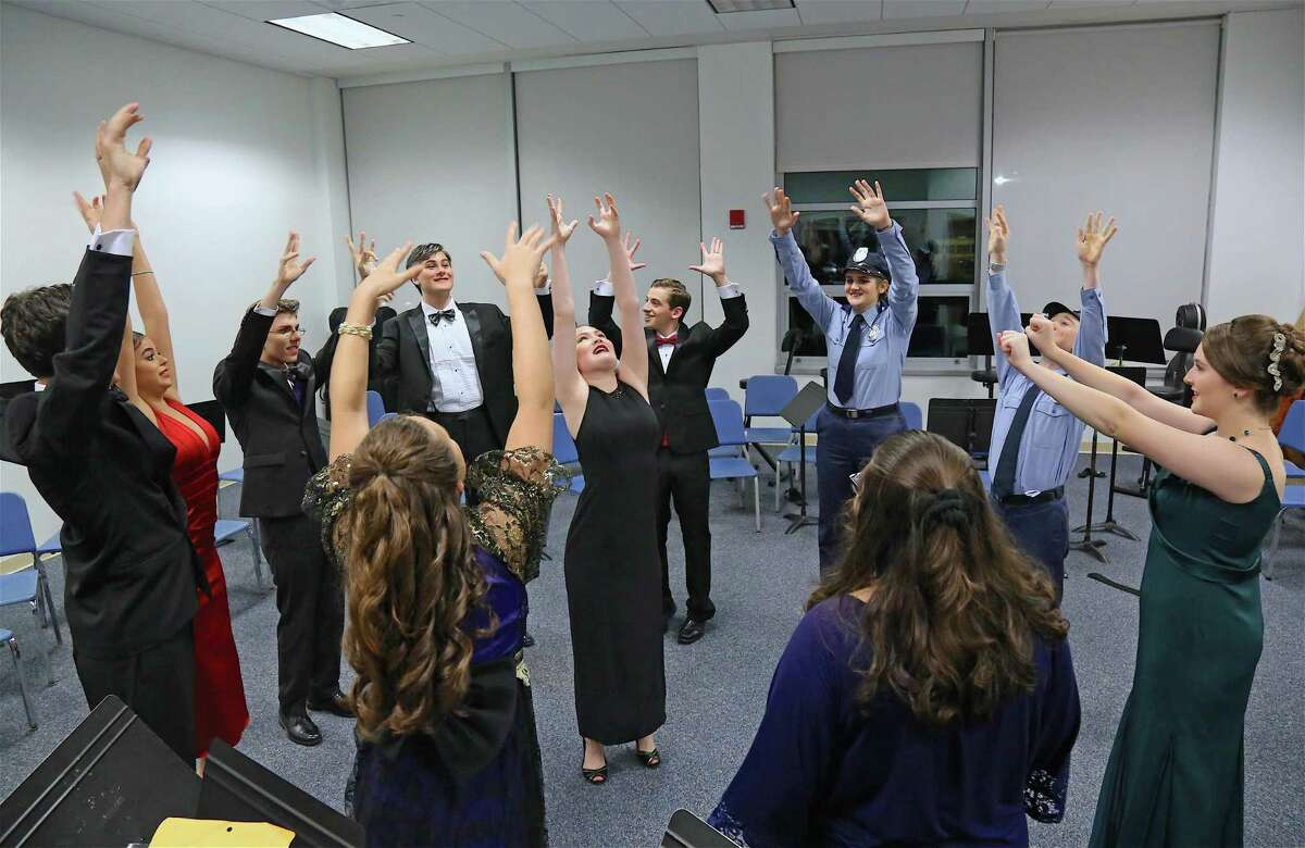 Actors do some warm-up exercises before the start of the performance of