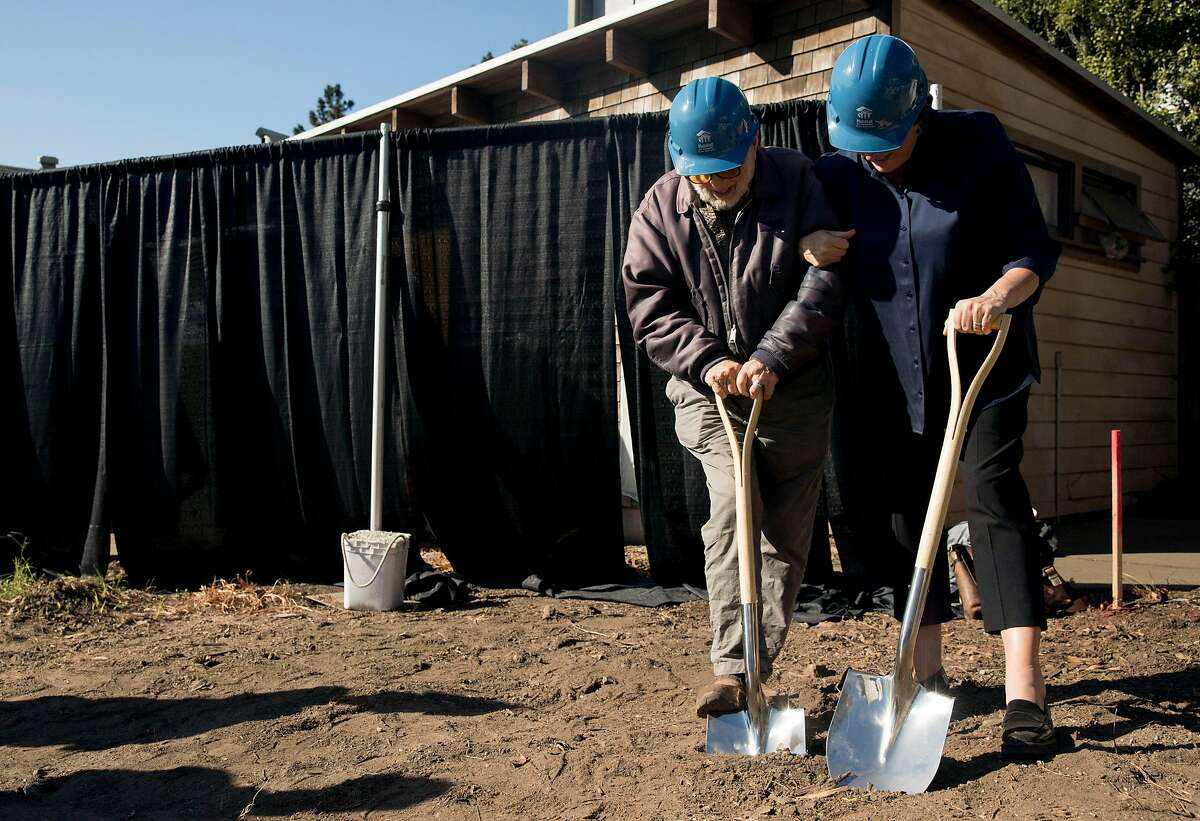 Mische Seligman, 98, (left) and Habitat for Humanity San Francisco CEO Maureen Sedonaen break ground on the site of his childhood home and inherited property on Amber Drive in Diamond Heights during ceremony for the start of construction on new affordable housing by Habitat for Humanity in San Francisco, Calif. Friday, Nov. 1, 2019.
