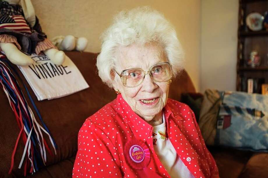 Kate Schlosser, who turns 106 years old today, poses for a portrait in her apartment at Riverside Place Tuesday afternoon. (Katy Kildee/kkildee@mdn.net)