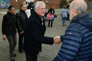 Norwalk Mayor Harry Rilling campaigns outside The West Rocks Middle School polling placeTuesday. November 5, 2019, in Norwalk, Conn.