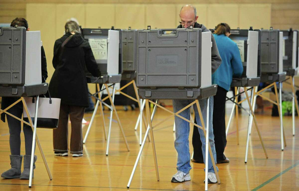 Voters cast their ballots in the West Rocks Middle School polling place Tuesday, November 5, 2019, in Norwalk, Conn.