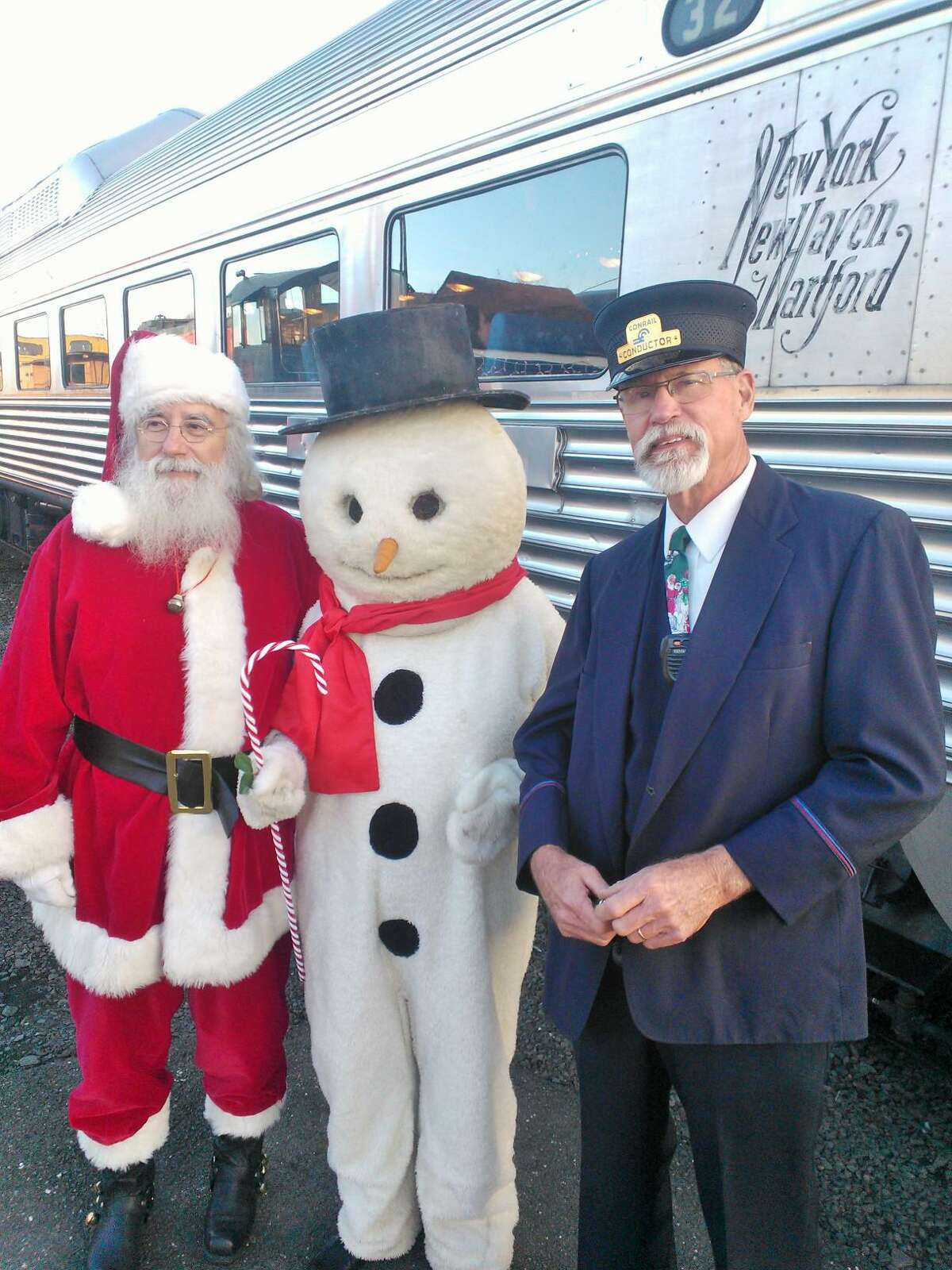 Santa, seen here with Frosty and conductor Jim Teer, will once again pay a visit to the Danbury Railway Museum December 7-8, 14-15 and 21-22.