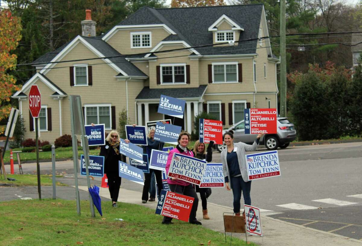 Candidates and volunteers for both parties outside Mill Hill Elementary School, the District 10 polling place.