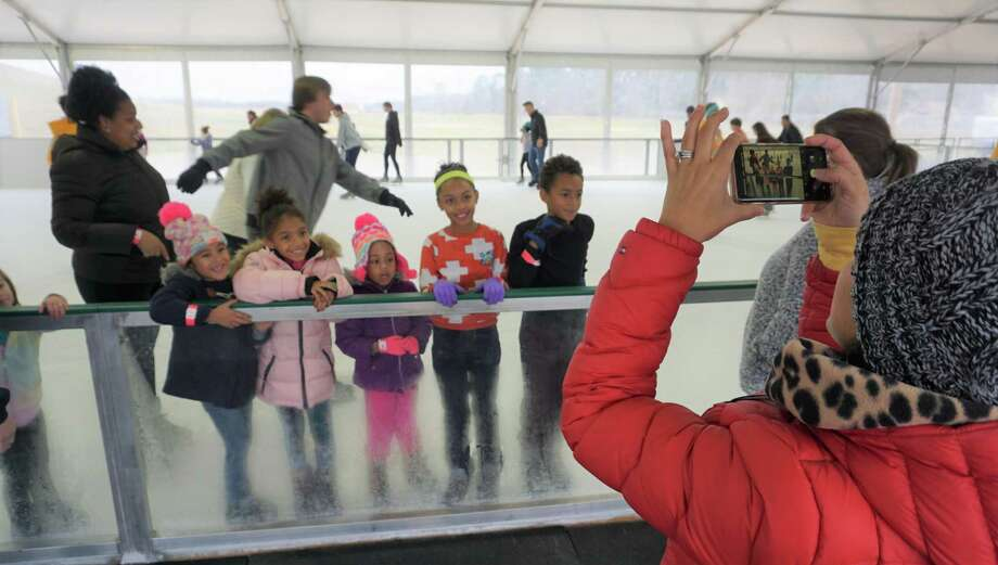 "East Montgomery County Improvement District kicks off its ""A Holiday to Remember"" event, going on from Dec. 29 to Jan. 6, with the opening of its ice-skating rink in New Caney's Valley Ranch Town Center.  The seasonal attraction, which uses real ice instead of synthetic, is the first of its kind in the county, and can hold 100 skaters of any skill level at any one time. ""For probably the past year our board has talked about bringing other community events into our area,"" said Frank McCrady, EMCID's president and CEO. ""There aren't many folks who got to experience ice or snow — we have snow at some of our other events — so we try to bring a bit of a flavor to our area that we don't normally have."" Photo: Nguyen Le / Staff Photo"