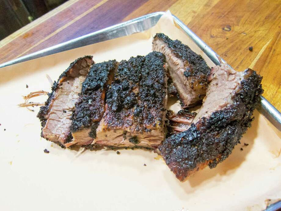 Texas style kosher brisket will be cooked at Sunday's Texas Kosher BBQ Championship at Congregation Agudas Achim, located on San Antonio's North Side at 16550 Huebner Road. Photo: J.C. Reid /Houston Chronicle / Houston Chronicle