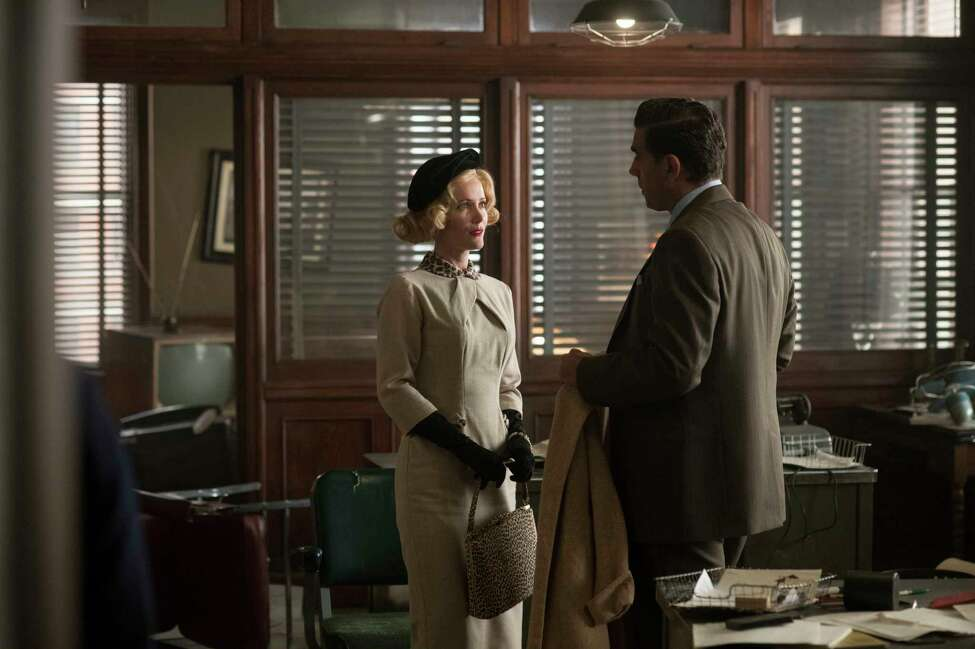 This image released by Warner Bros. shows Leslie Mann, left, and Bobby Cannavale in a scene from