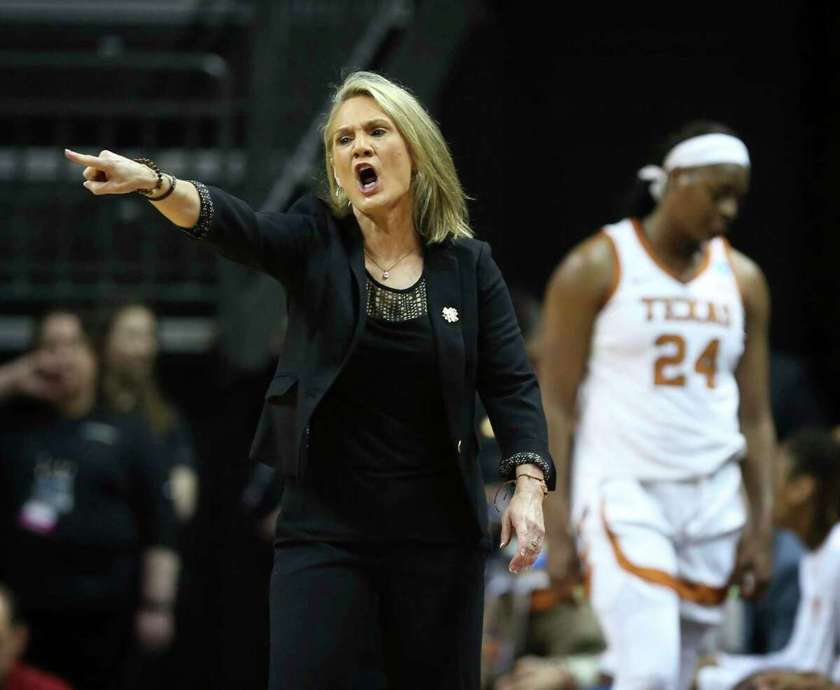 Texas coach Karen Aston, left, calls to her team during the first half against Indiana in an NCAA women's college basketball tournament game Friday, March 22, 2019, in Eugene, Ore. (AP Photo/Chris Pietsch)