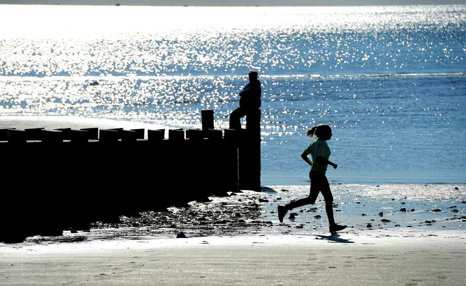A 10-year-old girl runs along the Old Saybrook Town Beach in this archive shot. Photo: Hearst Connecticut Media File Photo / ©2016 Peter Hvizdak